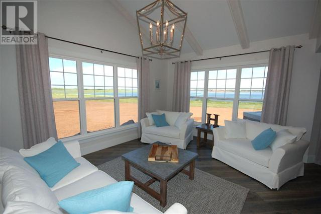 <p><span>296 Macmillan Point Road, West Covehead, P.E.I.</span><br> The home sits on 1.1 acres overlooking Covehead Bay, Stanhope Golf Course, sand dunes and the ocean.<br> (Photo: Zoocasa) </p>