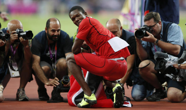 Trinidad and Tobago's Keshorn Walcott smiles to the photographers after winning gold in the men's javelin throw final at the London 2012 Olympic Games at the Olympic Stadium August 11, 2012. REUTERS/Stefan Wermuth (BRITAIN - Tags: OLYMPICS SPORT ATHLETICS MEDIA)