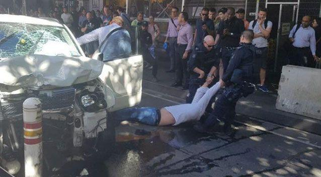 The alleged driver was dragged from the 4WD. Source: AAP