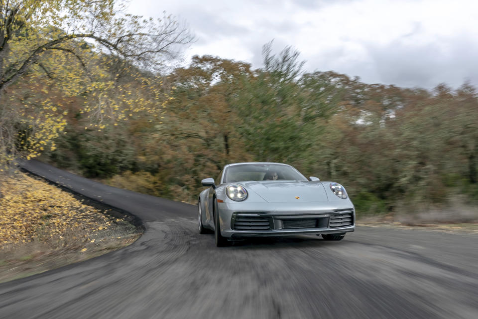 This photo provided by Porsche shows the 2020 Porsche 911. Available in base Carrera and Carrera S variants, the 911 offers a variety of performance capabilities. It can even be had with all-wheel drive. But how does it fare against its bargain rival, the 2020 Chevy Corvette? (Courtesy of Porsche Cars North America via AP)