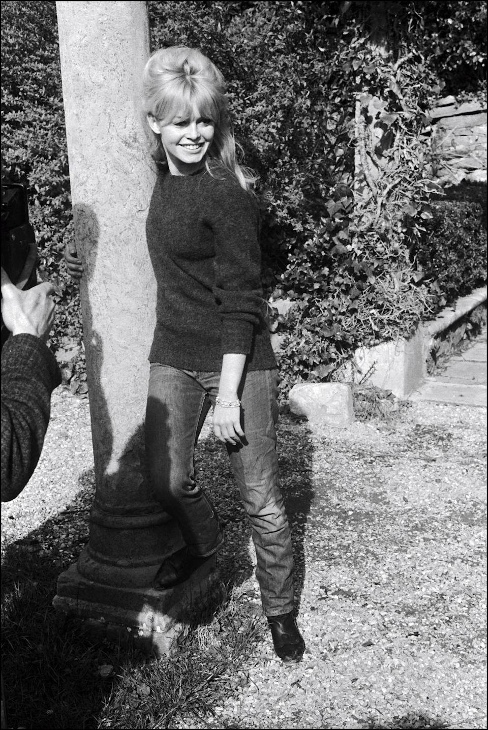 <p>Brigitte Bardot wears her pair slimmer in the leg, uncuffed, ushering in a decade of more bootcut styles. </p>
