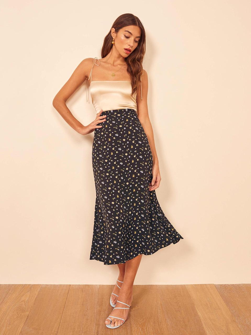 """<p>You'll own this <a href=""""https://www.popsugar.com/buy/Reformation-Bea-Skirt-573317?p_name=Reformation%20Bea%20Skirt&retailer=thereformation.com&pid=573317&price=90&evar1=fab%3Aus&evar9=47465187&evar98=https%3A%2F%2Fwww.popsugar.com%2Ffashion%2Fphoto-gallery%2F47465187%2Fimage%2F47465367%2FReformation-Bea-Skirt&list1=sales%2Csale%20shopping%2Creformation%2Cfashion%20shopping&prop13=api&pdata=1"""" class=""""link rapid-noclick-resp"""" rel=""""nofollow noopener"""" target=""""_blank"""" data-ylk=""""slk:Reformation Bea Skirt"""">Reformation Bea Skirt</a> ($90, originally $128) forever.</p>"""