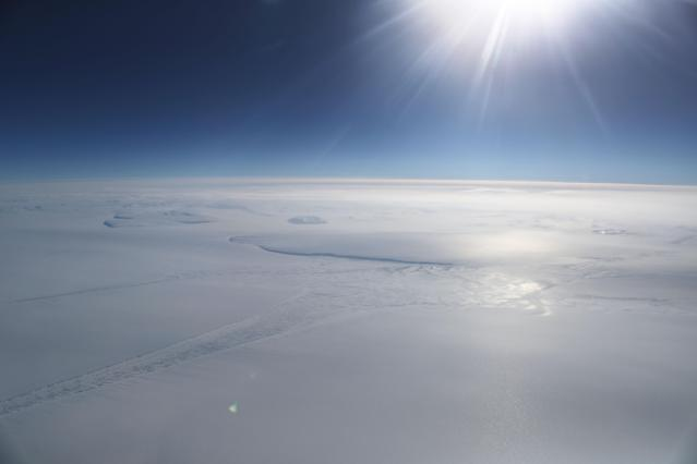 <p>Ice is seen from NASA's Operation IceBridge research aircraft in the Antarctic Peninsula region, on Nov. 4, 2017, above Antarctica. (Photo: Mario Tama/Getty Images) </p>