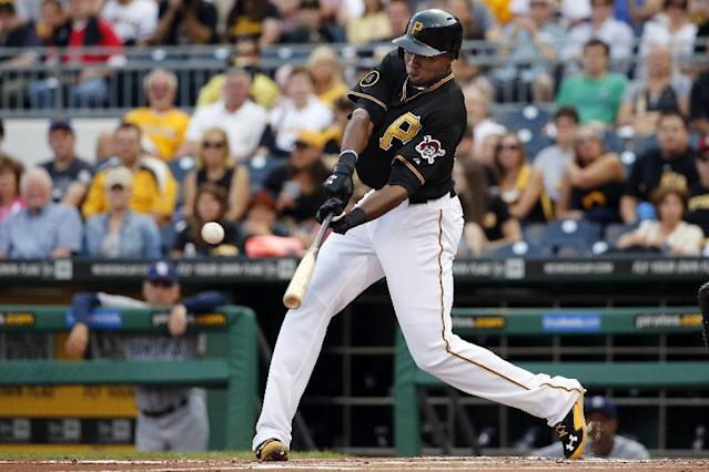 Pittsburgh Pirates' Gregory Polanco drives in a run with a single off San Diego Padres starting pitcher Ian Kennedy during the first inning of a baseball game in Pittsburgh, Friday, Aug. 8, 2014. (AP Photo/Gene J. Puskar)