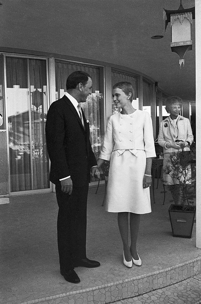 """<p>Frank Sinatra and Mia Farrow were married in a small ceremony at Las Vegas's Sands Hotel in 1966. Afterwards the couple greeted guests for <a href=""""https://www.marthastewart.com/7904799/mia-farrow-and-frank-sinatra-wedding-anniversary-day-history"""" rel=""""nofollow noopener"""" target=""""_blank"""" data-ylk=""""slk:a reception at the nearby home"""" class=""""link rapid-noclick-resp"""">a reception at the nearby home</a> of Sinatra's friend, Bill Goetz. Before long, they were off on their Palm Springs honeymoon. </p>"""