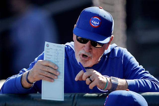 Cubs manager Joe Maddon is not thrilled with an upcoming rule change. (AP Photo/Charlie Riedel)