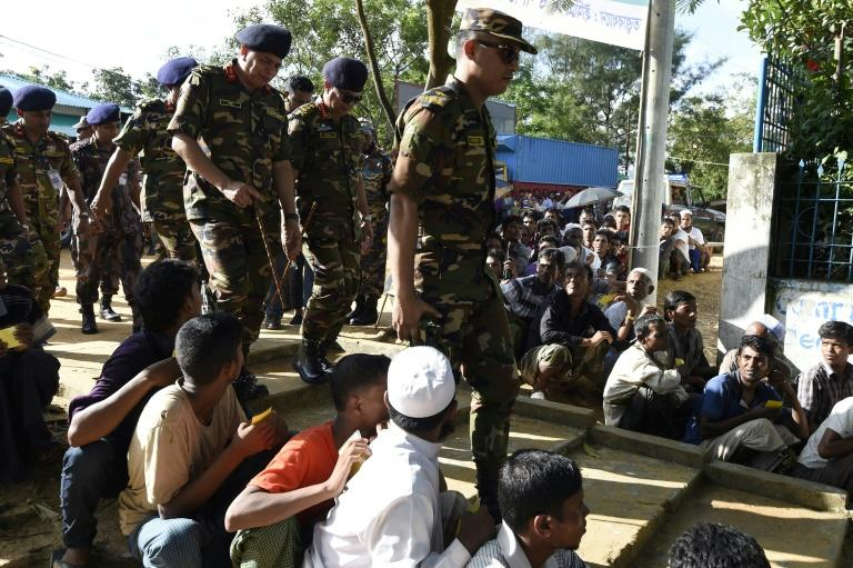 Chief of Army of Bangladesh, General Shafiul Huq (3R), visits the government's office for the registration of recently arrived Rohingya refugees in Ukhiya on September 21, 2017
