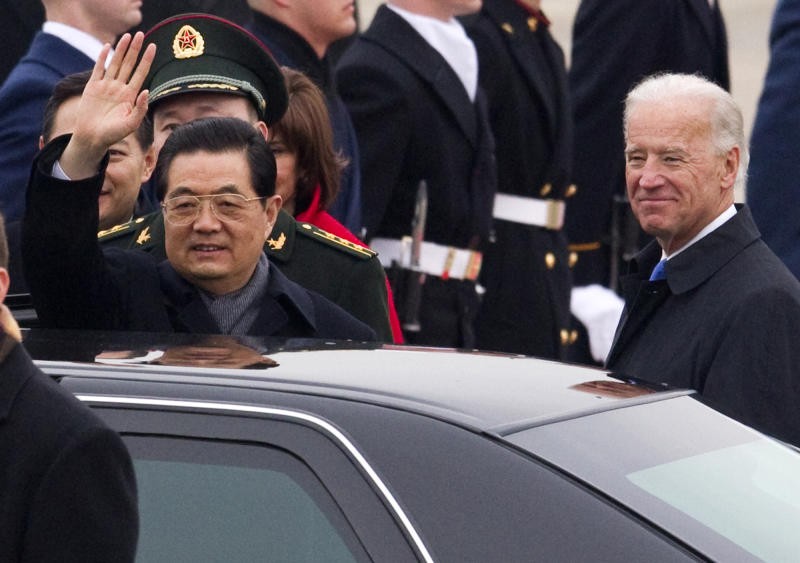 Chinese President Hu Jintao, accompanied Vice President Joe Biden, waves during an arrival ceremony, Tuesday, Jan. 18, 2011, at Andrews Air Force Base, Md. (AP Photo/Evan Vucci)