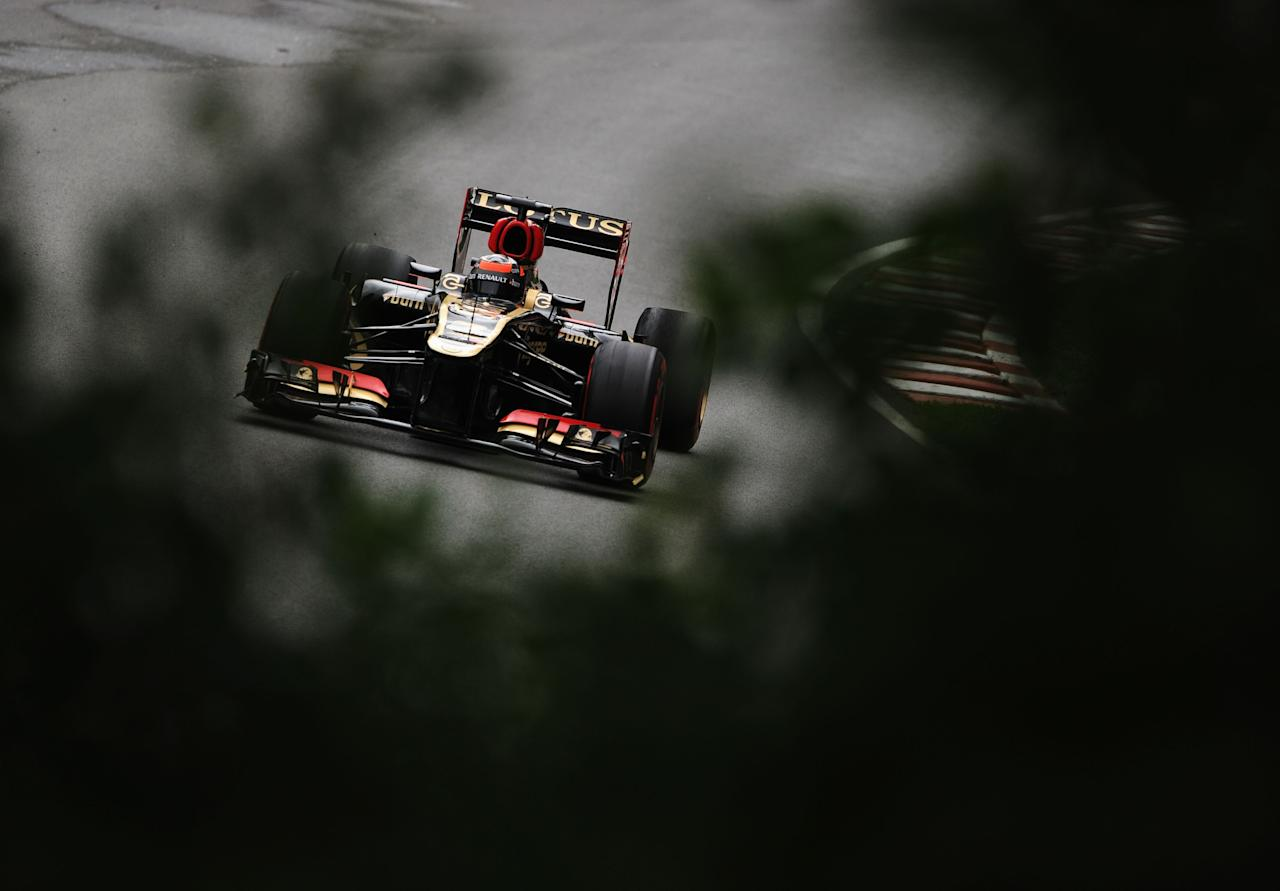 MONTREAL, QC - JUNE 07: Kimi Raikkonen of Finland and Lotus drives during practice for the Canadian Formula One Grand Prix at the Circuit Gilles Villeneuve on June 7, 2013 in Montreal, Canada. (Photo by Shaun Botterill/Getty Images)