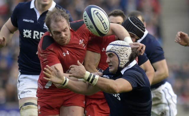 Alun Wyn Jones tackles Scotland's Blair Cowan, right, and jars the ball loose