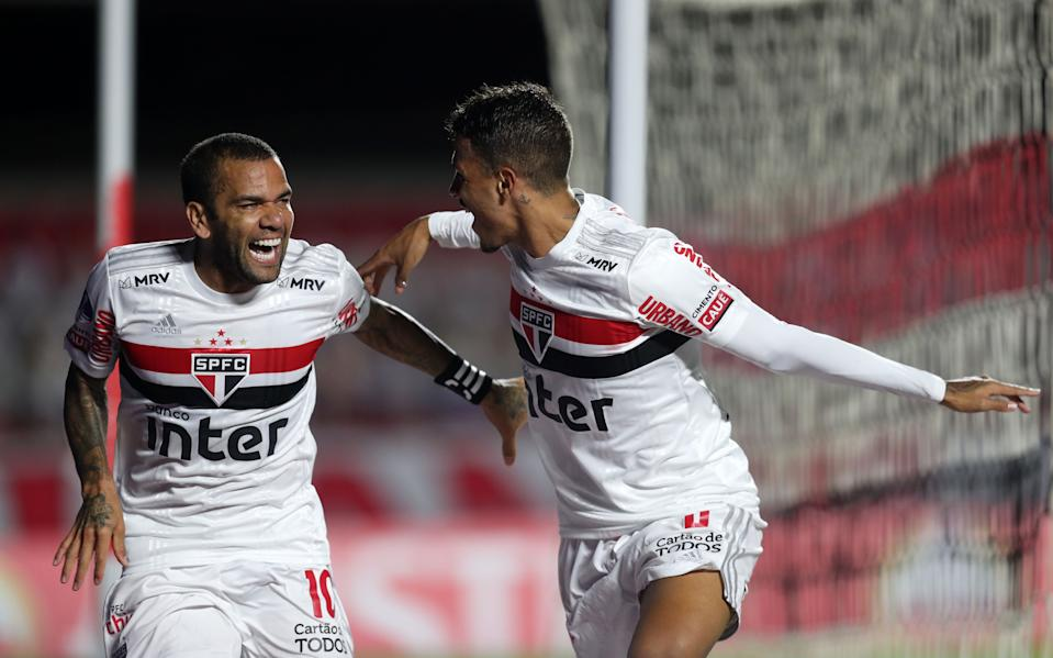 Brazil's Sao Paulo Dani Alves (L) celebrates with Brazil's Sao Paulo Diego Costa after scoring against Argentina's Lanus during their closed-door Copa Sudamericana second round football match at Morumbi Stadium in Sao Paulo, Brazil, on November 4, 2020, amid the COVID-19 novel coronavirus pandemic. (Photo by FERNANDO BIZERRA / POOL / AFP) (Photo by FERNANDO BIZERRA/POOL/AFP via Getty Images)