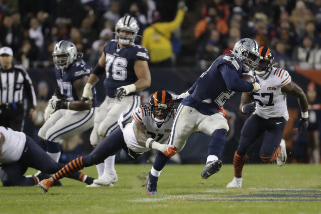 Dallas Cowboys' Ezekiel Elliott (21) runs out of a tackle of Chicago Bears' Ha Ha Clinton-Dix (21) during the first half of an NFL football game, Thursday, Dec. 5, 2019, in Chicago. (AP Photo/Morry Gash)
