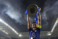 Chelsea's Cesar Azpilicueta celebrates with the trophy after winning the Champions League final soccer match between Manchester City and Chelsea at the Dragao Stadium in Porto, Portugal, Saturday, May 29, 2021. (AP Photo/Manu Fernandez, Pool)