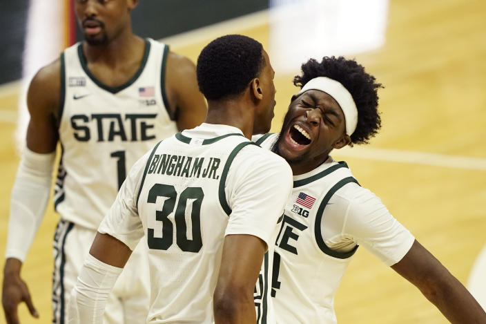 Michigan State forward Gabe Brown, right, and forward Marcus Bingham Jr. (30) celebrate a play during the second half of an NCAA college basketball game against Illinois, Tuesday, Feb. 23, 2021, in East Lansing, Mich. (AP Photo/Carlos Osorio)