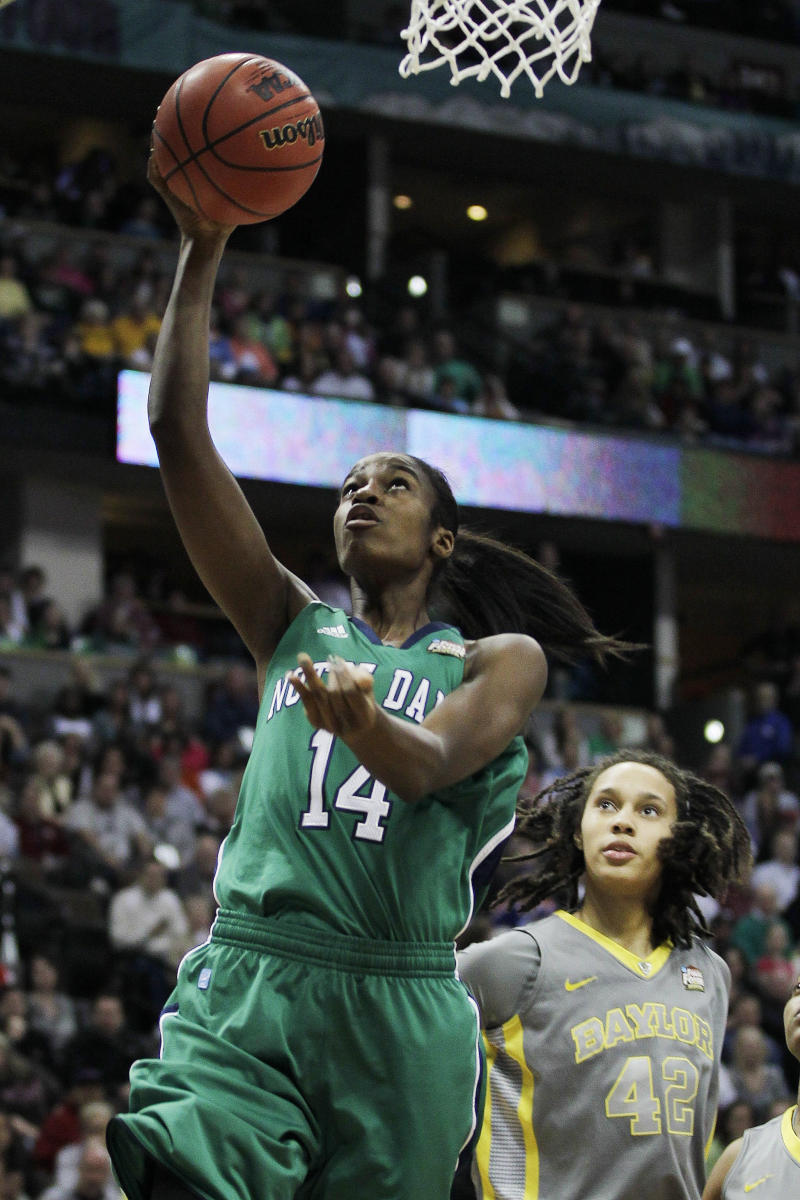 Notre Dame forward Devereaux Peters (14) shoots as Baylor center Brittney Griner (42) looks on during the first half in the NCAA women's Final Four college basketball championship game in Denver, Tuesday, April 3, 2012.  (AP Photo/Julie Jacobson)