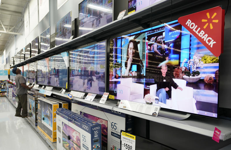 FILE - In this Nov. 9, 2018, file photo shoppers look at televisions at a Walmart Supercenter in Houston. Walmart Inc. reports earnings Thursday, Nov. 14, 2019. (AP Photo/David J. Phillip, File)