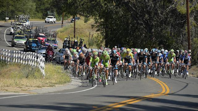 The peloton rides with Bradley Wiggins, in the yellow jersey, of Great Britain, during the final stage of the Tour of California cycling race, Sunday, May 18, 2014, in Thousand Oaks, Calif. (AP Photo/Mark J. Terrill)