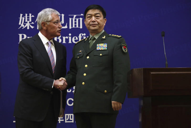 U.S. Defense Secretary Chuck Hagel, left, and Chinese Defense Minister Chang Wanquan shake hands at the end of a joint news conference at the Chinese Defense Ministry headquarters in Beijing, China Tuesday, April 8, 2014. The defense chiefs of China and the U.S. faced off Tuesday over Beijing's escalating territorial disputes in the region, as Hagel, wagging his finger, said China doesn't have the right to unilaterally establish an air defense zone over disputed islands with no consultation. (AP Photo/Alex Wong, Pool)