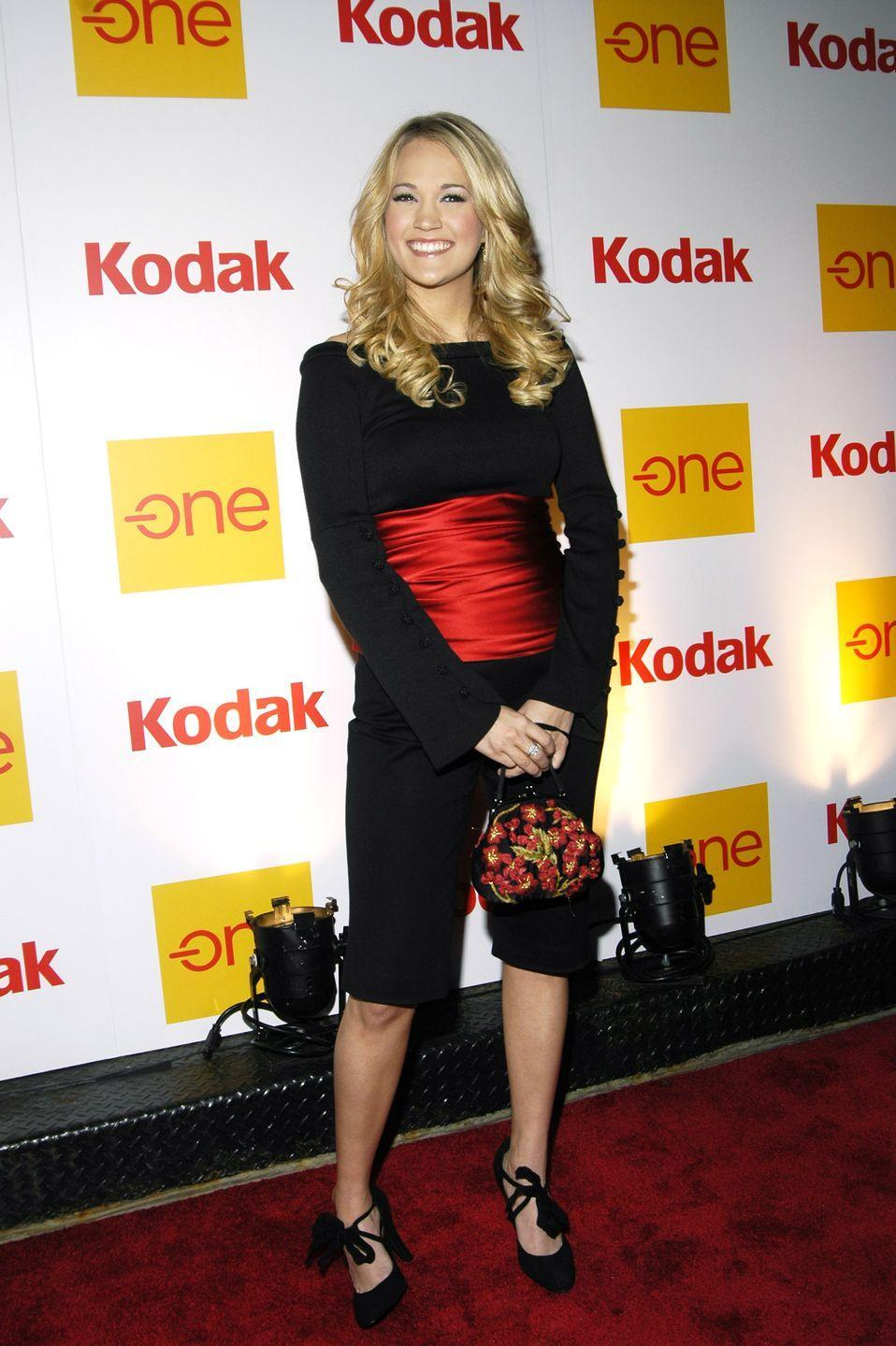 <p>Carrie wrapped herself up like a present with a red satin ribbon at the Country Takes New York City event.</p>