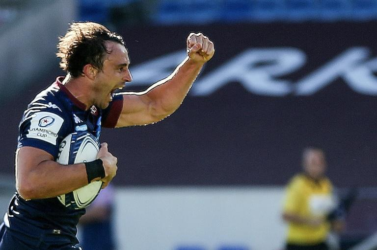 On the way to victory: Nans Ducuing celebrates the final try as Bordeaux-Begles beat Bristol