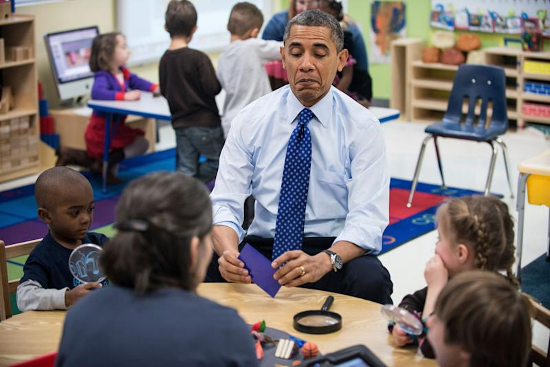 Obama plays a learning game while visiting children at College Heights Early Childhood Learning Center in Decatur, Georgia, in February 2012. (Photo: BRENDAN SMIALOWSKI via Getty Images)