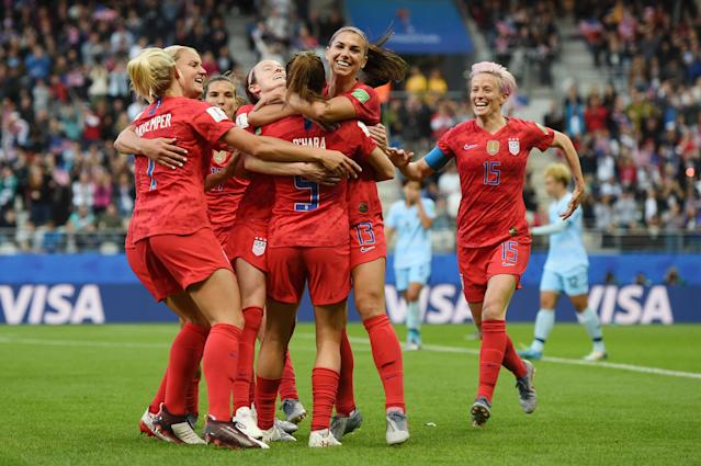 Alex Morgan of the USA celebrates with teammates after scoring her team's first goal during the 2019 FIFA Women's World Cup France group F match between USA and Thailand at Stade Auguste Delaune on June 11, 2019 in Reims, France. (Photo by Alex Caparros - FIFA/FIFA via Getty Images)