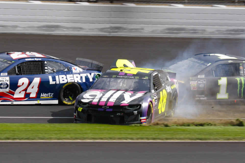 NASCAR driver Jimmie Johnson (48) makes contact with Kurt Busch (1) in the second turn during the NASCAR Brickyard 400 auto race at the Indianapolis Motor Speedway, Sunday, Sept. 8, 2019, in Indianapolis. (AP Photo/Bud Cunningham)