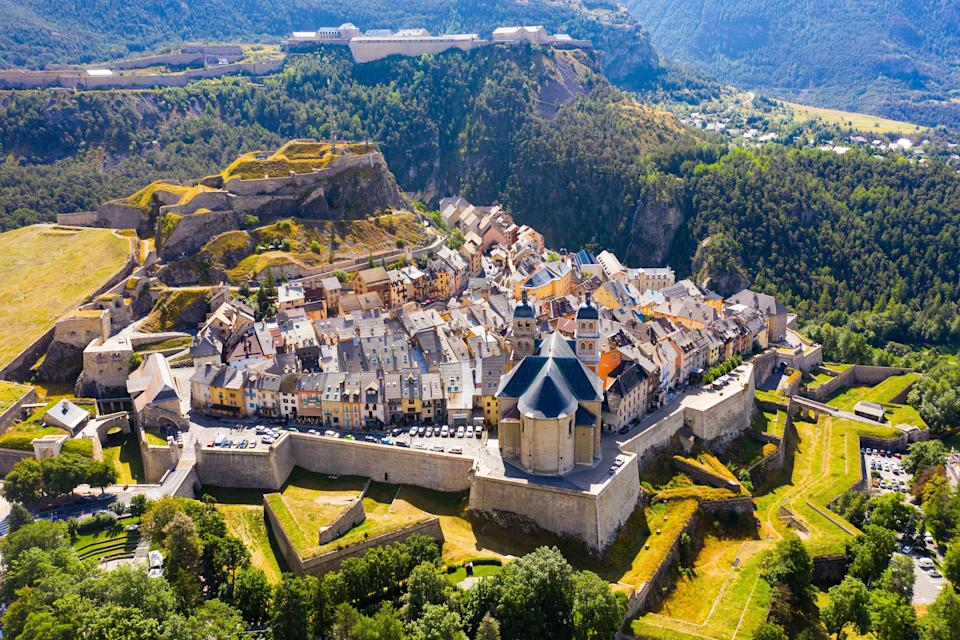 """<p><strong>Population:</strong> 12,370</p> <p>Sitting at an altitude of 4,350 feet, Briançon is considered the highest city in all of France. Several buildings in the fortified city are UNESCO World Heritage Sites (as part of the """"<a href=""""https://whc.unesco.org/en/list/1283"""" rel=""""nofollow noopener"""" target=""""_blank"""" data-ylk=""""slk:Fortifications of Vauban"""" class=""""link rapid-noclick-resp"""">Fortifications of Vauban</a>"""" listing), but the most famous landmark is undoubtedly the 18th-century parish church, defined by its two symmetrical towers. The town is also connected to the Serre Chevalier ski resort, making it a must-visit during the winter months.</p>"""