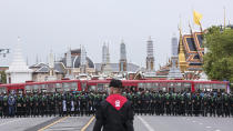 Police officers wearing face masks stand in line, protecting the area surrounding the Grand Palace during during a protest in Bangkok, Thailand, Sunday, Sept. 20, 2020. The mass student-led rally that began Saturday is the largest in a series of protests this year, with thousands camping overnight near the royal palace, demanding for new elections and reform of the monarchy.(AP Photo/Wason Wanichakorn)