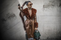 """Blogger Melis Ekrem is seen wearing a faux fur trench coat by Nasty Gal. <a href=""""https://fave.co/2UXxSzB"""" rel=""""nofollow noopener"""" target=""""_blank"""" data-ylk=""""slk:Shop the coat here"""" class=""""link rapid-noclick-resp"""">Shop the coat here</a> [Photo: Getty Images]"""