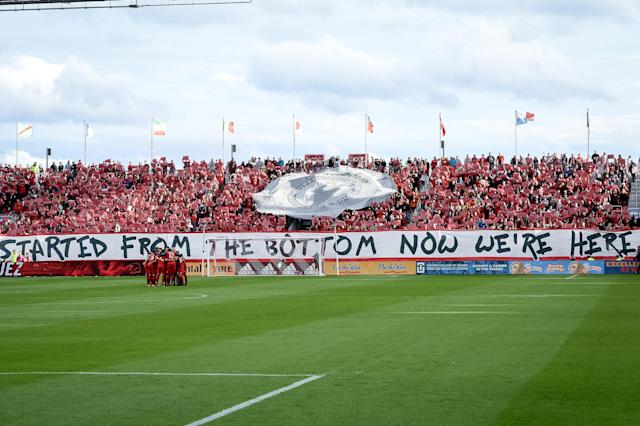 "A Drake-themed banner at BMO Field last Sunday read: ""Started from the bottom now we're here."" (Getty)"
