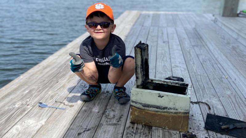 The young boy was fishing when he discovered a locked safe stolen from a nearby neighbour 10 years ago.