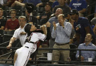 Arizona Diamondbacks catcher Caleb Joseph dives into the netting to make a catch on a foul ball hit by Los Angeles Dodgers' Enrique Hernandez during the fourth inning of a baseball game Wednesday, June 26, 2019, in Phoenix. (AP Photo/Ross D. Franklin)