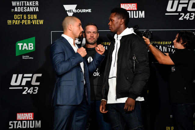 (L-R) Robert Whittaker and Israel Adesanya fight for the undisputed UFC middleweight title on Saturday at UFC 243 in Melbourne, Australia. (Getty Images)