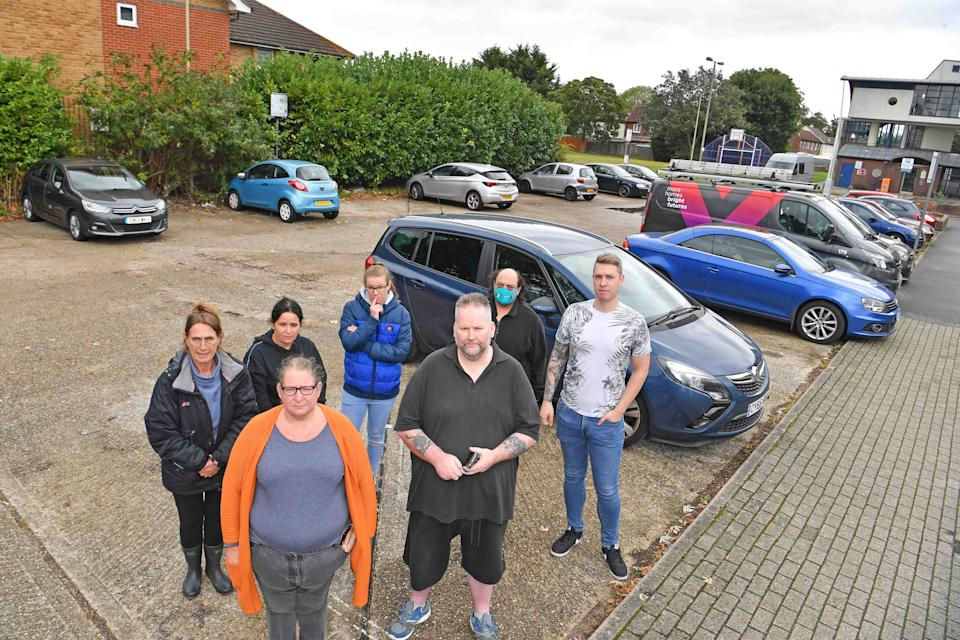 Angry residents of Totland Close, Farnborough, in their car parking area, which was once council owned and free, but has now been taken over by a private firm who intend charging the residents £150 a month to park there. It is one of the county's most deprived areas. (Reach)