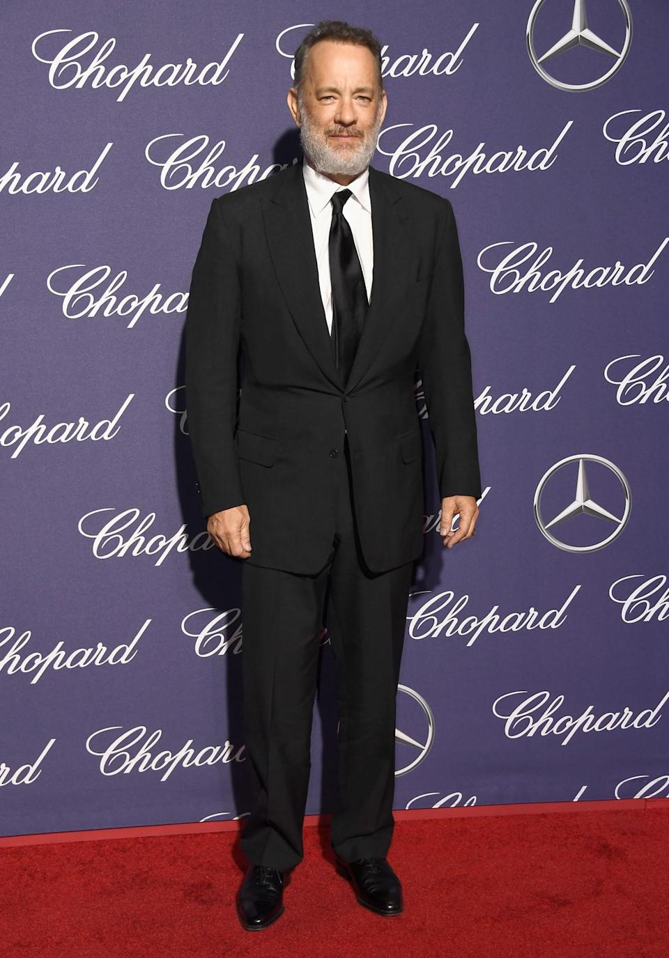 <p>Hanks paired his smart suit with 2016's best male accessory – a great beard. [Photo: Getty] </p>