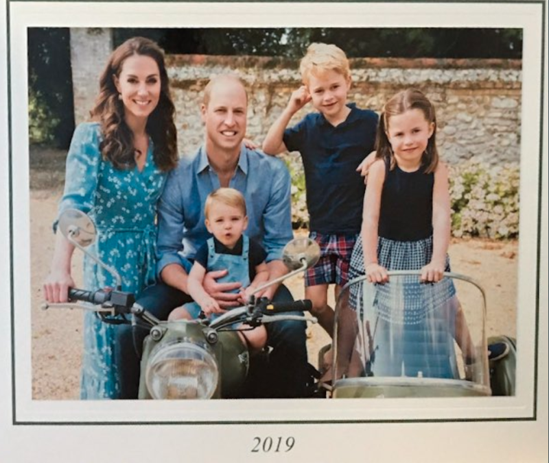 The Cambridge family Kate Middleton Prince William Prince Louis Prince George and Princess Charlotte posing on a motorbike