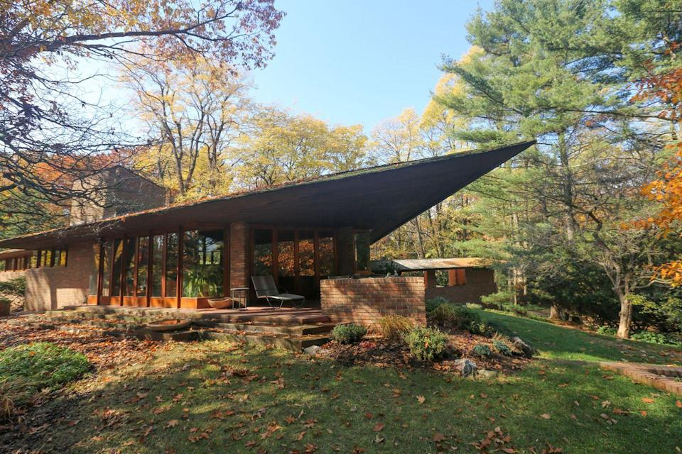 """<p>This high-drama, late-period Frank Lloyd Wright <a href=""""https://franklloydwright.org/site/palmer-house/"""" rel=""""nofollow noopener"""" target=""""_blank"""" data-ylk=""""slk:dwelling"""" class=""""link rapid-noclick-resp"""">dwelling</a> was completed in 1950 for William and Mary Palmer. The two-acre property features a three-bedroom main house—with its prowlike, triangular cantilever—and an adjacent tea house, built after Wright's death by his apprentice, John H. Howe, in 1959.</p><p>The main home (which is listed on the National Register of Historic Places), with its open and airy interiors, has original furniture designed by Wright and built-in cabinetry. And while you're in Ann Arbor, be sure to pay a visit to the University of Michigan Museum of Art. </p><p>Book your stay <a href=""""https://www.vrbo.com/246204"""" rel=""""nofollow noopener"""" target=""""_blank"""" data-ylk=""""slk:here"""" class=""""link rapid-noclick-resp"""">here</a>.</p>"""