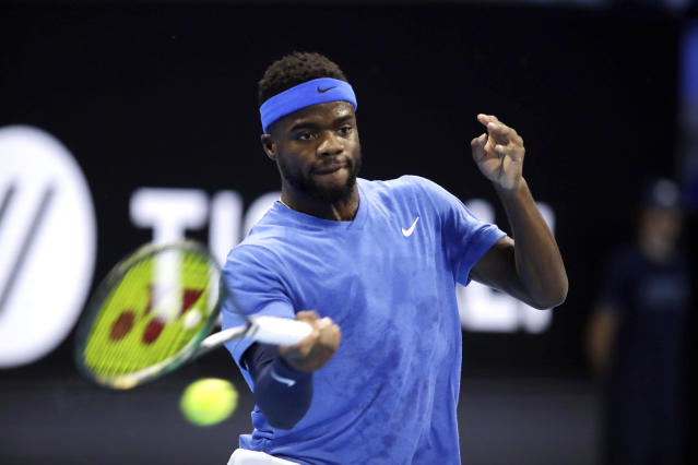Frances Tiafoe of the United States returns the ball to Alex De Minaur of Australia, during their ATP Next Gen tennis tournament semifinal match, in Milan, Italy, Friday, Nov. 8, 2019. (AP Photo/Luca Bruno)