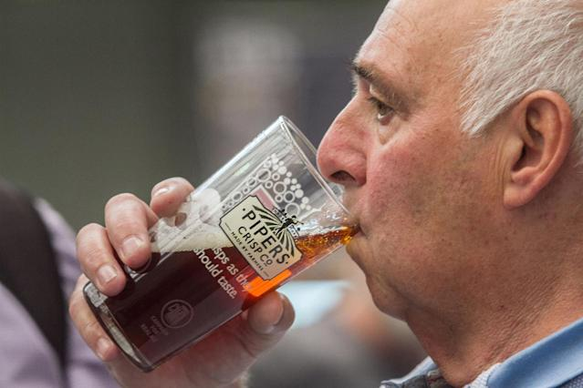 <p>A visitor enjoys a pint at the Great British Beer Festival, August 8, 2017 in London, England. (Photo: Amer Ghazzal/REX/Shutterstock) </p>