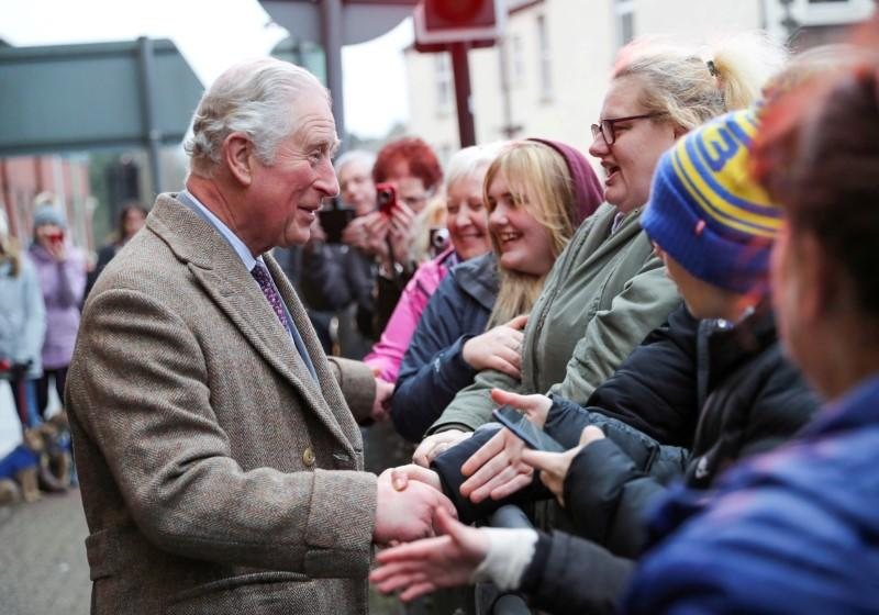 FILE PHOTO: Britain's Prince Charles visits the town of Pontypridd affected by recent floods in Wales