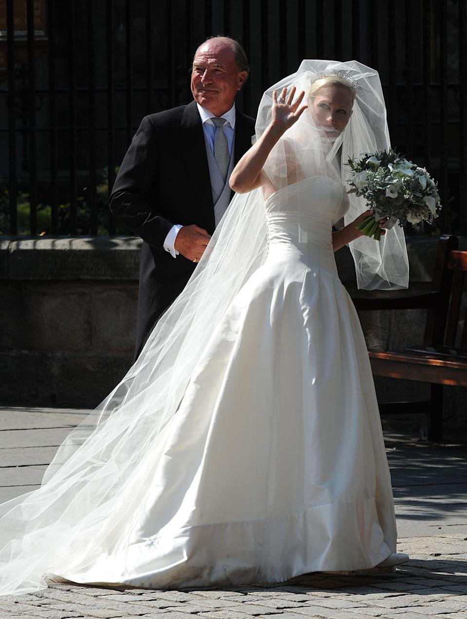 "<p>Phillips, granddaughter of the Queen, chose a sleeveless design by <a href=""https://www.harpersbazaar.com/uk/bazaar-brides/a15892164/who-is-stewart-parvin-meghan-markle-wedding-dress/"" rel=""nofollow noopener"" target=""_blank"" data-ylk=""slk:Stewart Parvin"" class=""link rapid-noclick-resp"">Stewart Parvin</a> that featured a beautiful ball gown skirt.</p>"