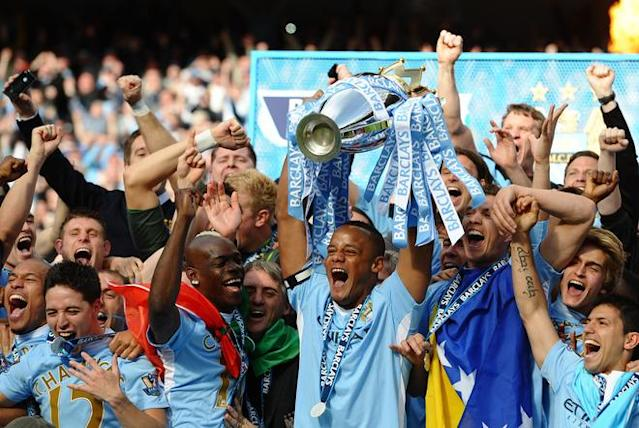 Manchester City's Belgian captain Vincent Kompany lifts the Premier league trophy after their 3-2 victory over Queens Park Rangers in the English Premier League football match between Manchester City and Queens Park Rangers at The Etihad stadium in Manchester, north-west England on May 13, 2012. Manchester City won the game 3-2 to secure their first title since 1968. This is the first time that the Premier league title has been decided on goal-difference, Manchester City and Manchester United both finishing on 89 points. AFP PHOTO/PAUL ELLIS RESTRICTED TO EDITORIAL USE. No use with unauthorized audio, video, data, fixture lists, club/league logos or 'live' services. Online in-match use limited to 45 images, no video emulation. No use in betting, games or single club/league/player publications.PAUL ELLIS/AFP/GettyImages