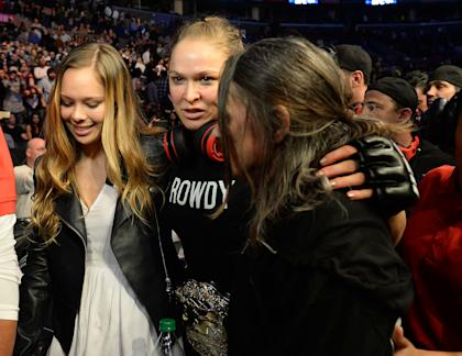 Ronda Rousey leaves the arena with sister Julia De Mars and mother AnnMaria De Mars after her win. (USAT)