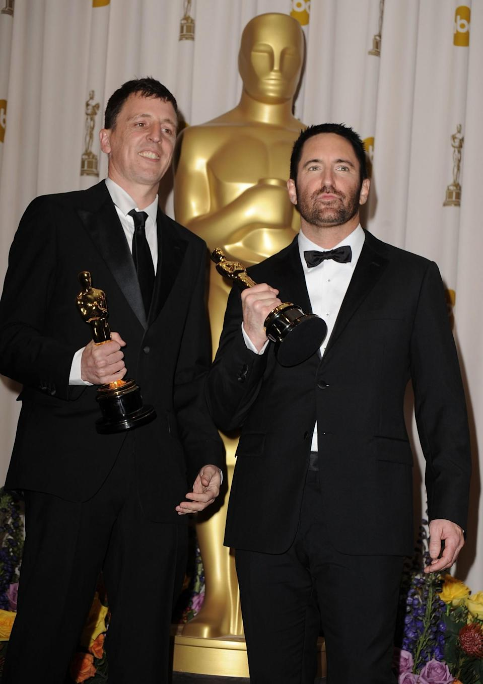 HOLLYWOOD, CA - FEBRUARY 27: Composers Atticus Ross (L) and Trent Reznor pose in the press room during the 83rd Annual Academy Awards held at the Kodak Theatre on February 27, 2011 in Hollywood, California. (Photo by Steve Granitz/WireImage)