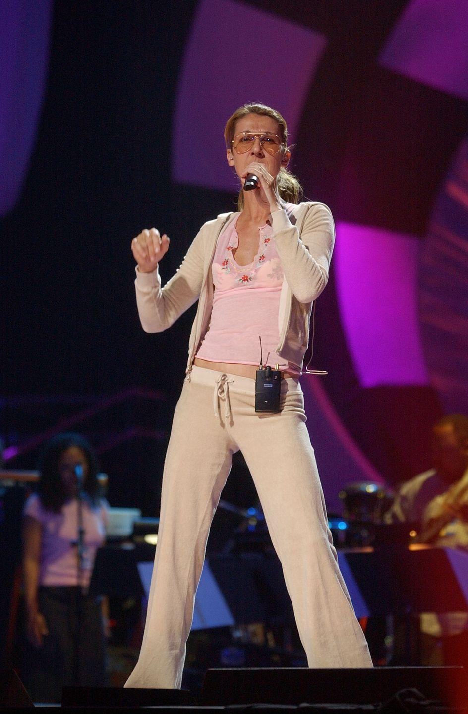 <p>Aviators and a velour tracksuit? It must be 2002. While Dion is known for taking fashion risks, this wasn't one of them. She wore this iconic combo for the VH1 Divas Las Vegas rehearsal.</p>