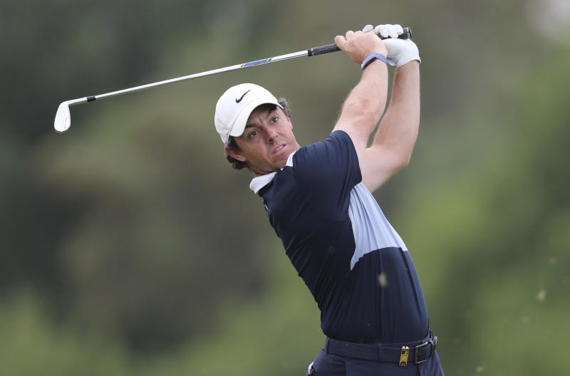 Rory McIlroy of Northern Ireland watches his ball on the 3rd hole during the first round of the DP World Tour Championship golf tournament in Dubai, United Arab Emirates, Thursday, Nov. 21, 2019. (AP Photo/Kamran Jebreili)