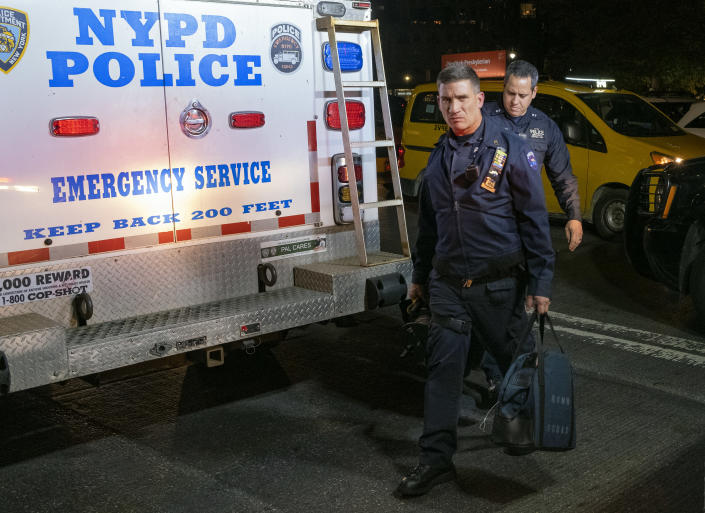 """<p>New York City police (NYPD) clear the scene after a report of a possible suspicious package was called in at the Time Warner Center Thursday, Oct. 25, 2018, in New York. The NYPD had said it had evaluated the packages """"as a precaution"""" on Thursday night. (Photo: Craig Ruttle/AP) </p>"""