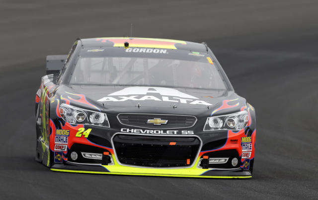 Jeff Gordon drives through Turn 1 during the Brickyard 400 auto race at Indianapolis Motor Speedway in Indianapolis, Sunday, July 27, 2014. (AP Photo/Tom Strattman)