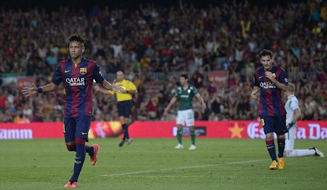Barcelona's Neymar, from Brazil, left, reacts after scoring against Leon during the Joan Gamper trophy friendly soccer match at the Camp Nou in Barcelona, Spain, Monday, Aug. 18, 2014. (AP Photo/Manu Fernandez)